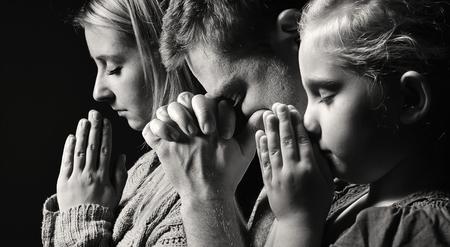 Photo pour Praying family. Man, woman and child. - image libre de droit