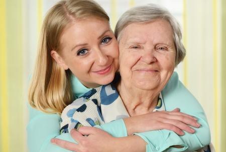 Foto de Senior woman with her caregiver. Happy and smiling. - Imagen libre de derechos