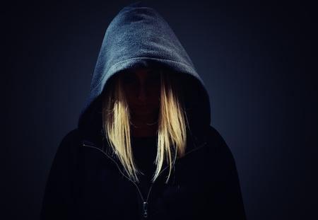 Foto de Mysterious, unknown woman  in the hood. - Imagen libre de derechos