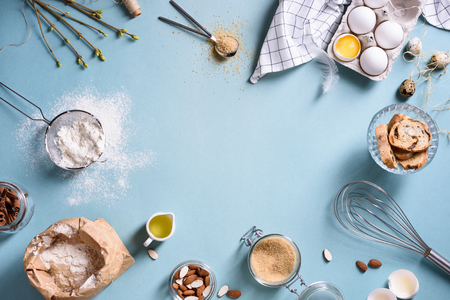Photo for Baking or cooking background frame. Ingredients, kitchen items for baking cakes. Kitchen utensils, flour, eggs, almond, cinnamon, oil. Text space, top view. - Royalty Free Image