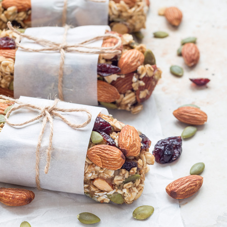 Photo for Homemade granola energy bars with figs, oatmeal, almond, dry cranberry and pumpkin seeds, healthy snack, square format - Royalty Free Image