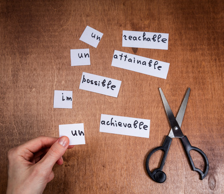 Photo pour Self motivation concept. Negative words cut with scissors and became positive. - image libre de droit