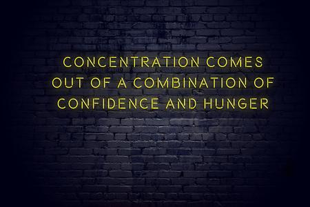 Foto de Neon sign with positive wise motivational quote against brick wall . - Imagen libre de derechos