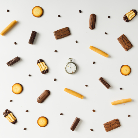 Photo for Bright sweet snack pattern with vintage pocket watch. Time concept. - Royalty Free Image