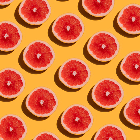 Photo pour Grapefruit pattern on yellow background. Minimal flat lay concept. - image libre de droit