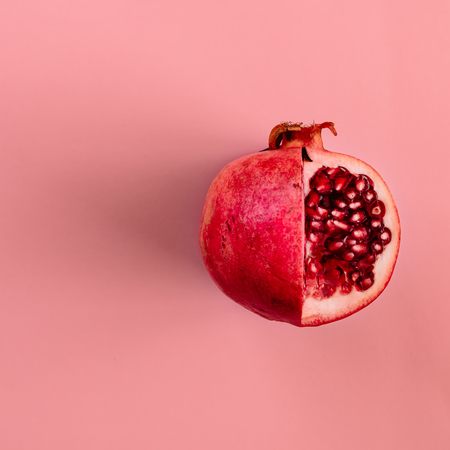 Photo for Red pomegranate fruit on pastel pink background. Minimal flat lay concept. - Royalty Free Image