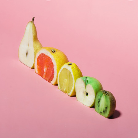 Photo for Various fruits sliced in half. Minimal concpet. - Royalty Free Image
