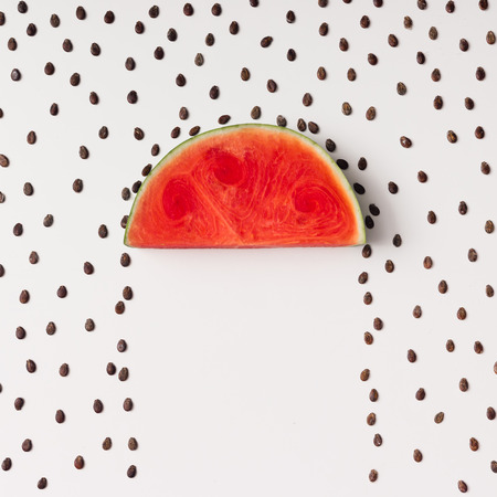 Photo for Watermellon slice with seeds raining. Flat lay. Weather concept. - Royalty Free Image