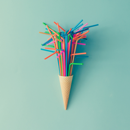 Photo for Ice cream cone with colorful drinking straws on bright blue background. Minimal food concept. Flat lay. - Royalty Free Image