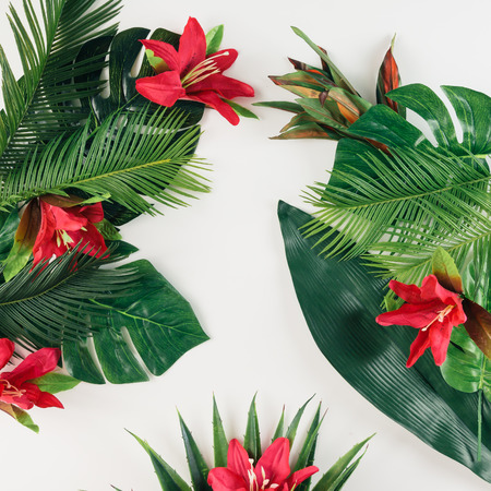 Photo for Creative layout made of tropical palm leaves and colorful flowers. Summer concept. Flat lay. - Royalty Free Image