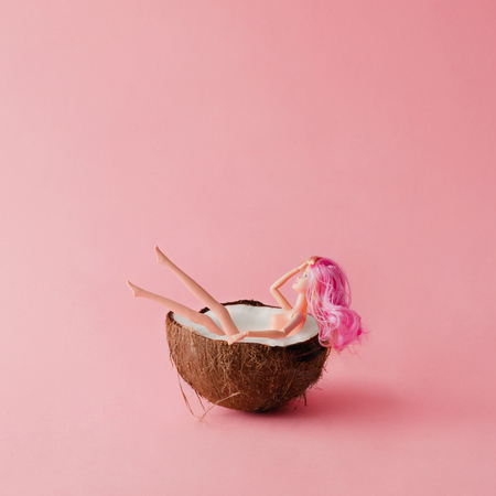 Photo for Doll with pink hair bathing in coconut. Summer concept. - Royalty Free Image