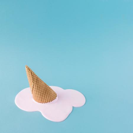Foto de Overhead pink ice cream on pastel blue background. Minimalistic summer food concept. - Imagen libre de derechos