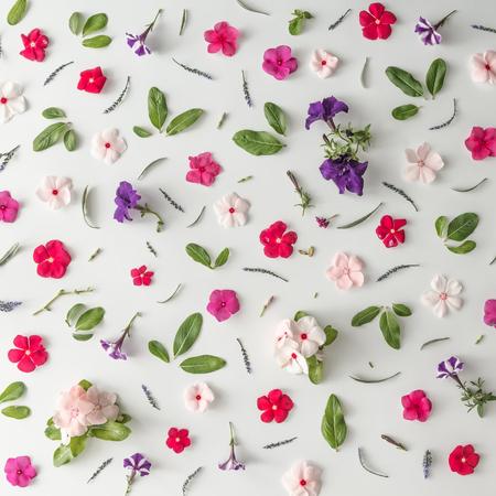 Foto de Creative pattern layout made of various flowers. Flat lay. Nature background - Imagen libre de derechos