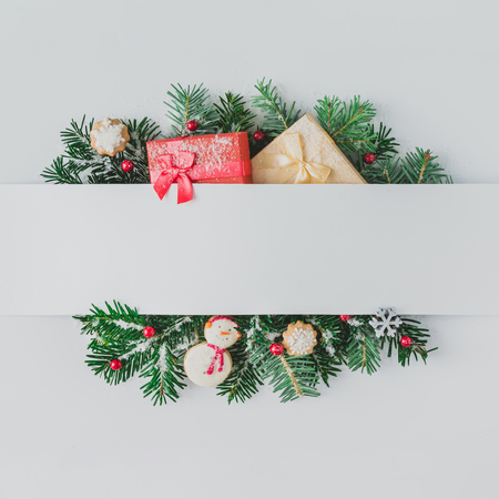 Foto de Creative layout made of Christmas tree branches with decoration and snow. Flat lay. Nature New Year concept. - Imagen libre de derechos