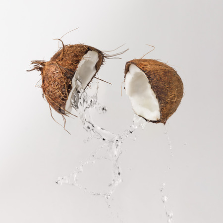 Photo for Cracked coconut with water splash. Summer tropical concept. - Royalty Free Image