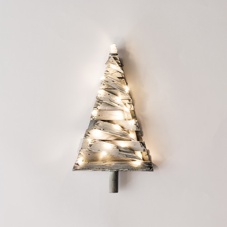 Photo for Minimalistic Christmas tree with lights on bright background. New Year nature minimal concept. - Royalty Free Image