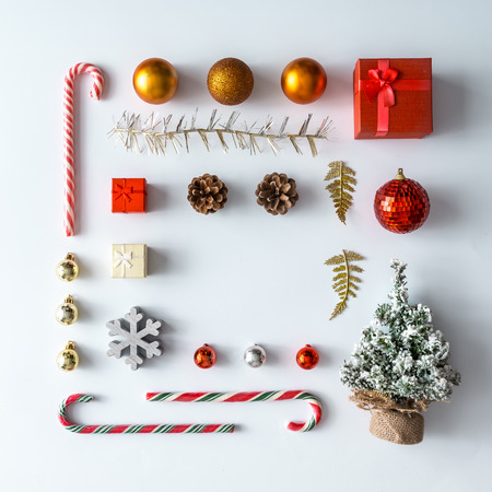 Foto de Creative Christmas layout made of christmas winter decoration. Flat lay. Nature New Year concept. - Imagen libre de derechos