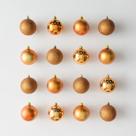 Foto de Golden Christmas baubles decoration on bright background. Flat lay. Holiday concept. - Imagen libre de derechos