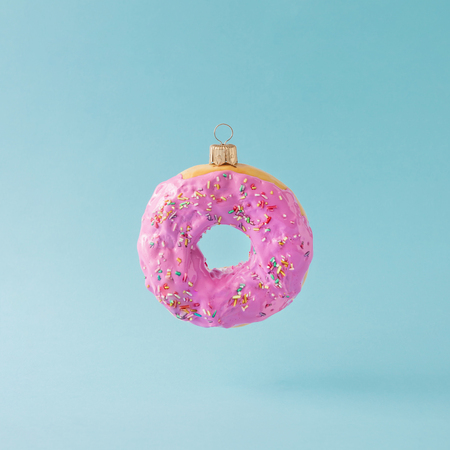 Photo for Christmas bauble decoration made of pink doughnut. Minimal New year concept. - Royalty Free Image