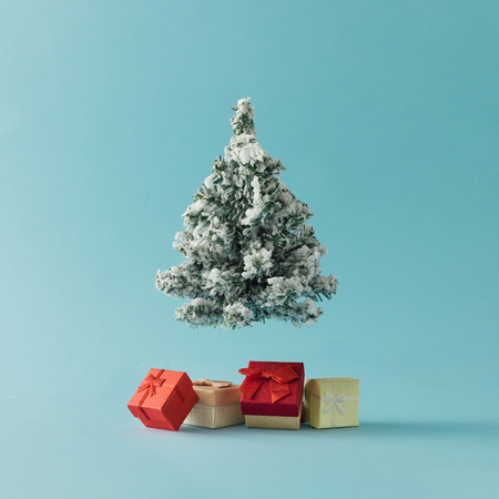Foto de Christmas Tree with gift boxes on bright blue background. Minimal holiday concept. - Imagen libre de derechos