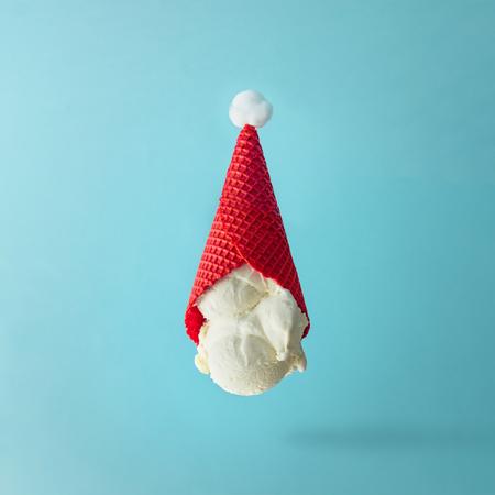 Foto de Santa Claus hat made of upside down vanilla ice cream. Christmas holiday minimal concept. - Imagen libre de derechos