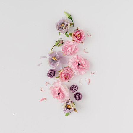 Photo for Creative layout made with pink and violet flowers on bright background. Flat lay. Spring minimal concept. - Royalty Free Image