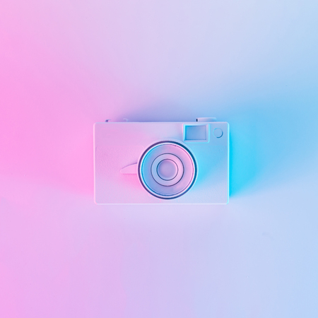 Photo for Vintage camera in vibrant bold gradient purple and blue holographic colors. Concept art. Minimal summer surrealism. - Royalty Free Image