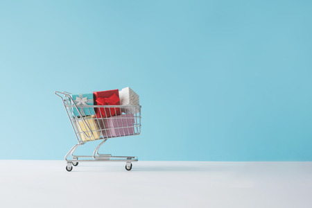 Photo for Shopping cart full with gift boxes. Minimal concept. - Royalty Free Image