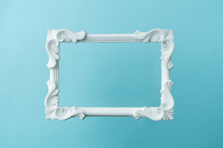 Photo for White vintage frame on pastel blue background. Minimal border composition. - Royalty Free Image