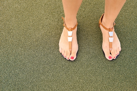 Photo for Sandals on women`s feet. - Royalty Free Image