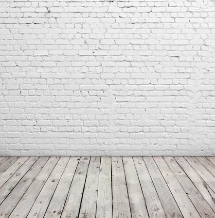 Foto de Old white brick wall and wood floor. - Imagen libre de derechos