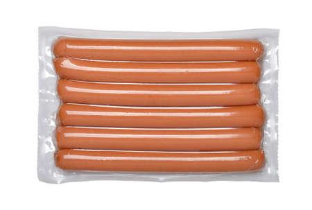 Foto de Pack of the sausages isolated on a white background. - Imagen libre de derechos