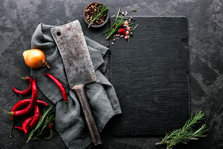 Photo for dark culinary background with empty black slate board and space for text recipe or meat menu - Royalty Free Image