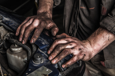 Photo pour Working men with dirty hands stay near car engine - image libre de droit
