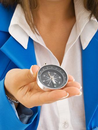 Foto de Woman in formal wear holding a compass - Imagen libre de derechos