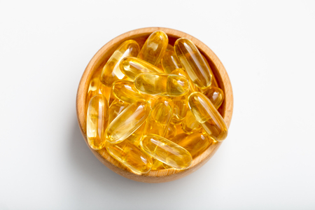 Foto de Fish oil capsules with omega 3 and vitamin D. healthy diet concept - Imagen libre de derechos