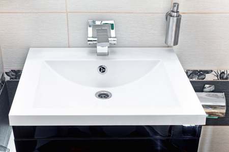 White sink and soap dispenser