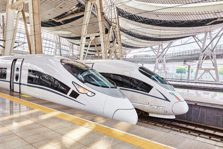 Foto per BEIJING, CHINA- MAY 23, 2015: High speed train at the railways station of  Beijing. Speed train is  comfortable and speed and most convenience in China Republic. - Immagine Royalty Free
