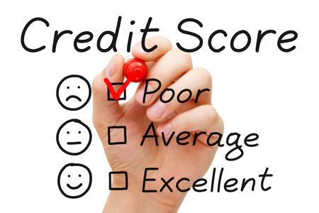 Foto de Hand putting check mark with red marker on poor credit score evaluation form. - Imagen libre de derechos