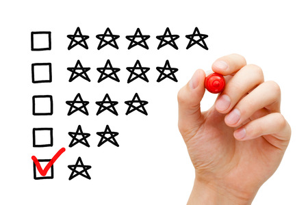 Photo for Hand putting check mark with red marker on poor one star rating. - Royalty Free Image