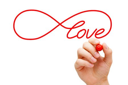 Photo for Hand sketching Infinity Love symbol with red marker on transparent wipe board. Concept about finding the endless love. - Royalty Free Image