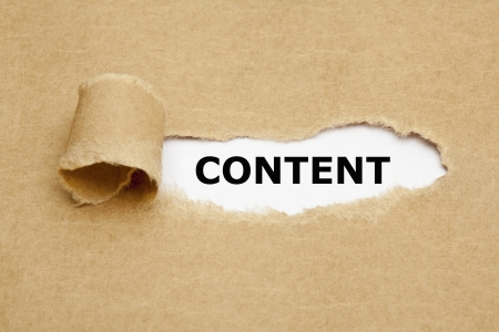Photo pour The word Content appearing behind torn brown paper. - image libre de droit
