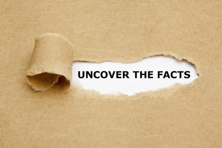 Photo for Uncover The Facts appearing behind torn brown paper.  - Royalty Free Image