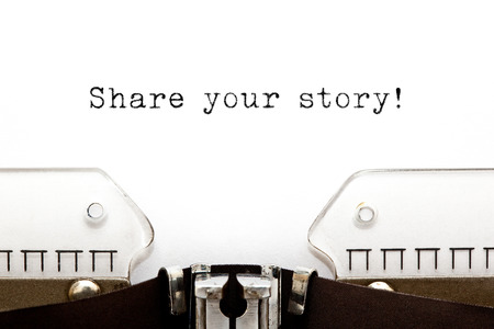 Photo pour Share Your Story typed on a old typewriter. - image libre de droit