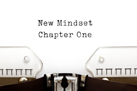 Foto de New Mindset Chapter One printed on an old typewriter. - Imagen libre de derechos