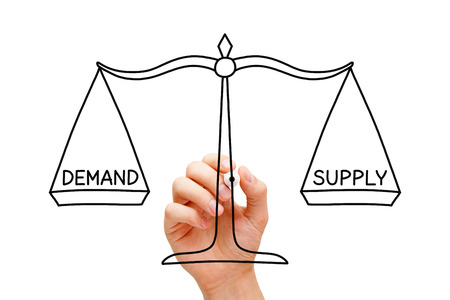 Foto de Hand drawing Demand Supply scale concept with black marker on transparent wipe board isolated on white. - Imagen libre de derechos