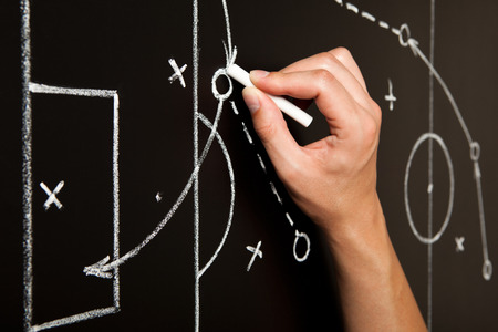 Photo for Hand drawing a soccer game tactics with white chalk on blackboard. - Royalty Free Image