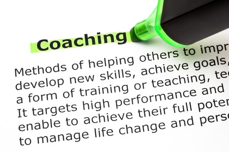 Foto de Definition of the word Coaching, highlighted with green text marker. - Imagen libre de derechos