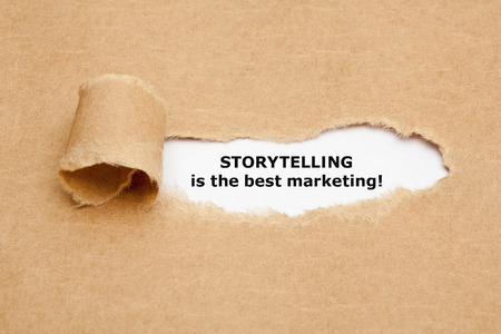 Foto de The motivational quote Storytelling is the best Marketing, appearing behind torn brown paper. - Imagen libre de derechos
