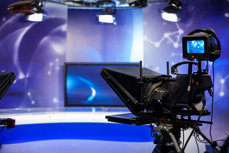 Photo for Video camera lens - recording show in TV studio - focus on camera - Royalty Free Image
